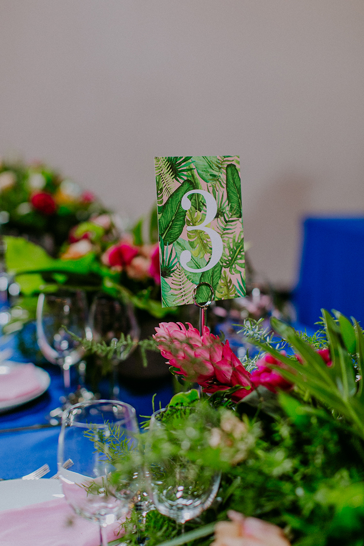 tropical table number signage - photo by Amber Gress Photography http://ruffledblog.com/jurassic-park-meets-the-golden-girls-for-this-brooklyn-wedding