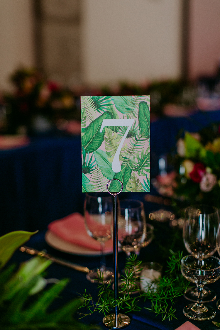 tropical table numbers - photo by Amber Gress Photography http://ruffledblog.com/jurassic-park-meets-the-golden-girls-for-this-brooklyn-wedding