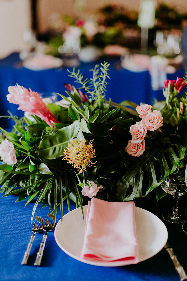tropical inspired wedding tablescapes - photo by Amber Gress Photography https://ruffledblog.com/jurassic-park-meets-the-golden-girls-for-this-brooklyn-wedding
