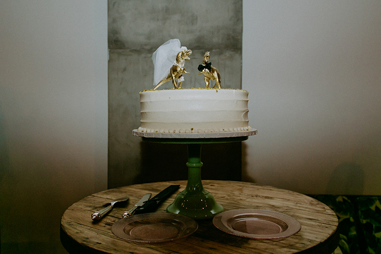 dinosaur cake toppers - photo by Amber Gress Photography https://ruffledblog.com/jurassic-park-meets-the-golden-girls-for-this-brooklyn-wedding