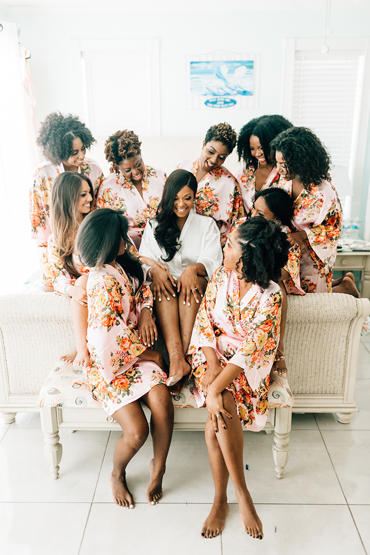 floral bridesmaid robes - photo by Finding Light Photography https://ruffledblog.com/key-largo-wedding-with-amazing-orchids-and-hydrangea
