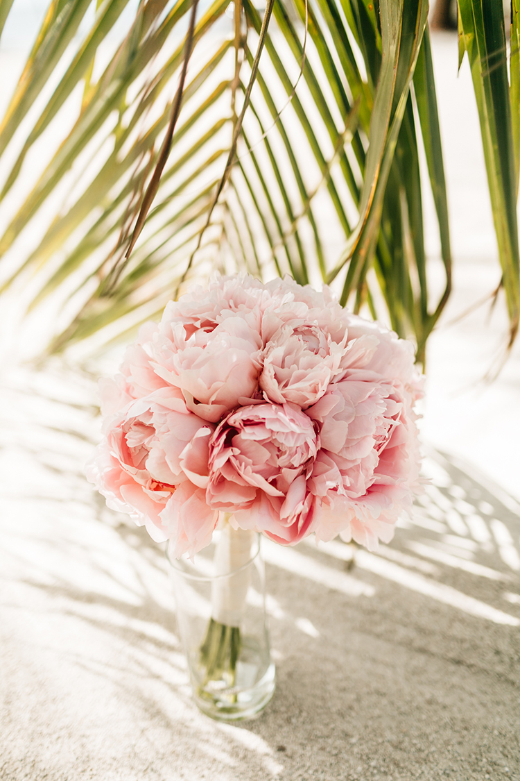 pink peony bouquets - photo by Finding Light Photography https://ruffledblog.com/key-largo-wedding-with-amazing-orchids-and-hydrangea