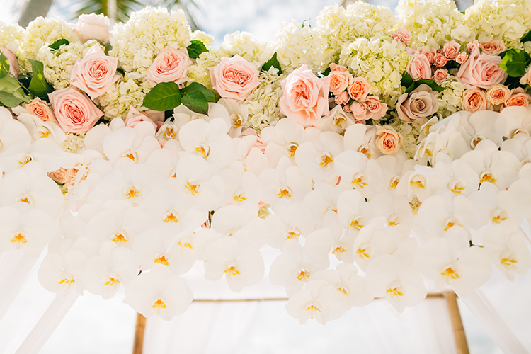 floral arches with orchids - photo by Finding Light Photography https://ruffledblog.com/key-largo-wedding-with-amazing-orchids-and-hydrangea