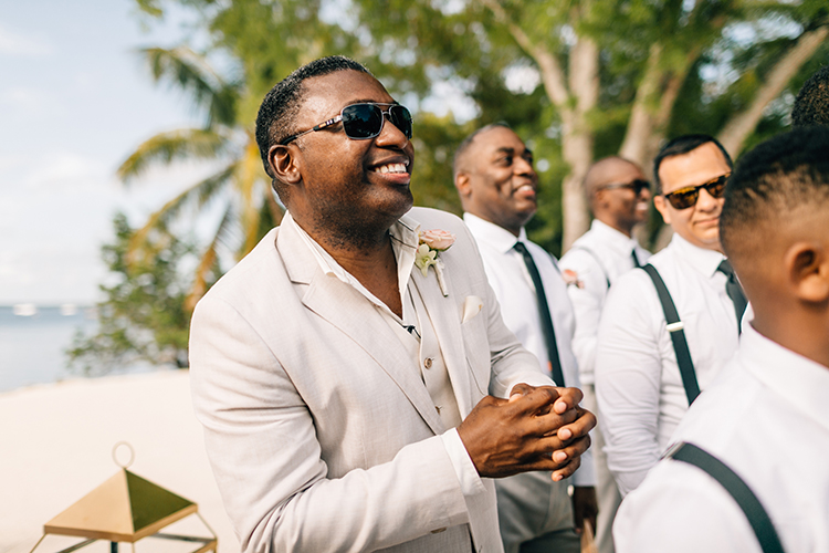 groom reaction during the ceremony - photo by Finding Light Photography https://ruffledblog.com/key-largo-wedding-with-amazing-orchids-and-hydrangea
