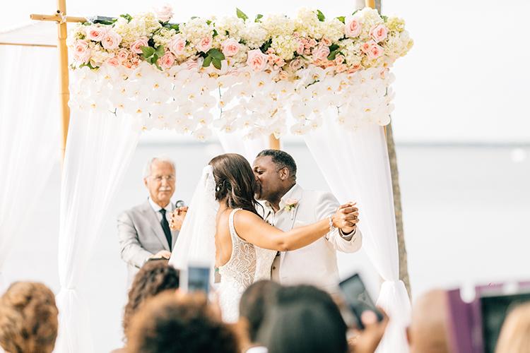 ceremony kiss - photo by Finding Light Photography https://ruffledblog.com/key-largo-wedding-with-amazing-orchids-and-hydrangea
