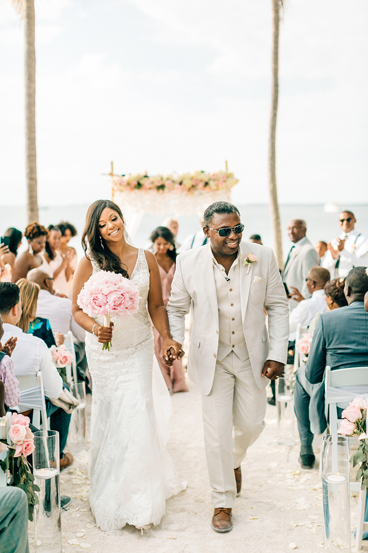 ceremony recessionals - photo by Finding Light Photography https://ruffledblog.com/key-largo-wedding-with-amazing-orchids-and-hydrangea