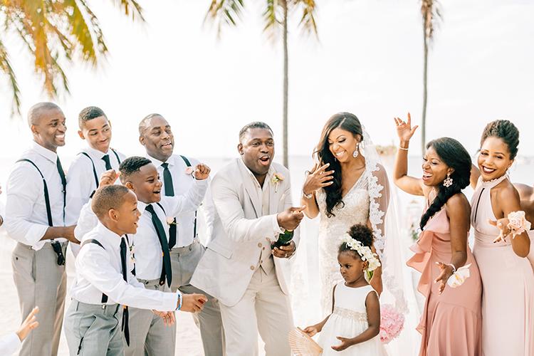 champagne wedding toasts - photo by Finding Light Photography https://ruffledblog.com/key-largo-wedding-with-amazing-orchids-and-hydrangea