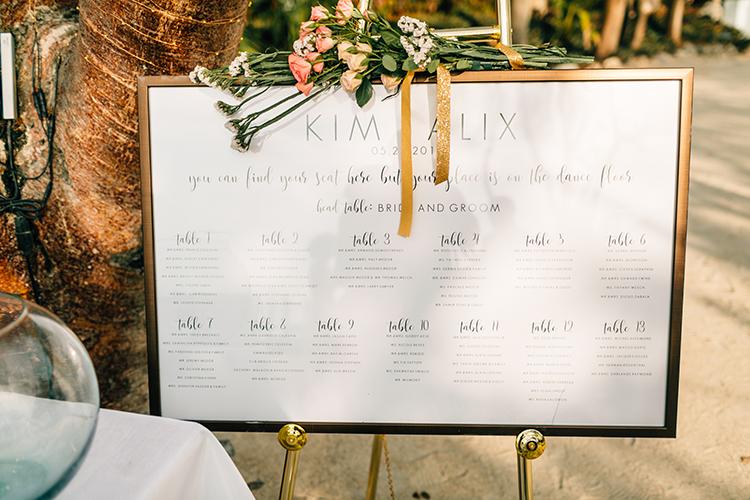 wedding seating charts - photo by Finding Light Photography https://ruffledblog.com/key-largo-wedding-with-amazing-orchids-and-hydrangea