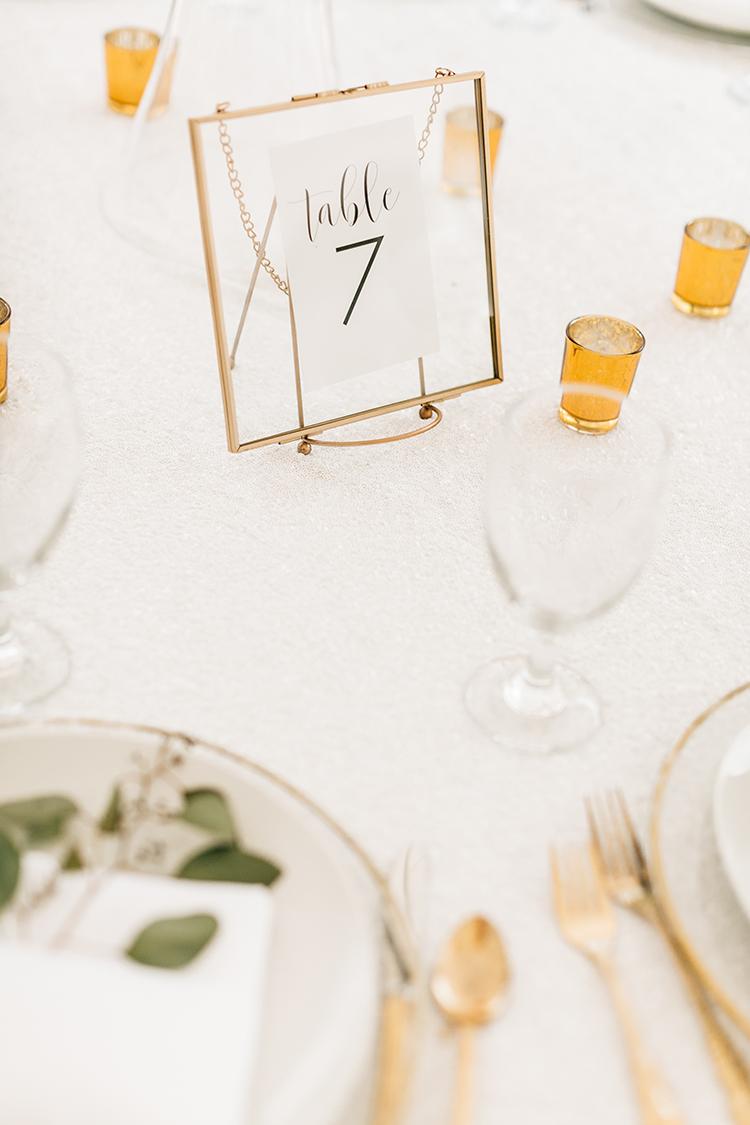 gold wedding details - photo by Finding Light Photography https://ruffledblog.com/key-largo-wedding-with-amazing-orchids-and-hydrangea