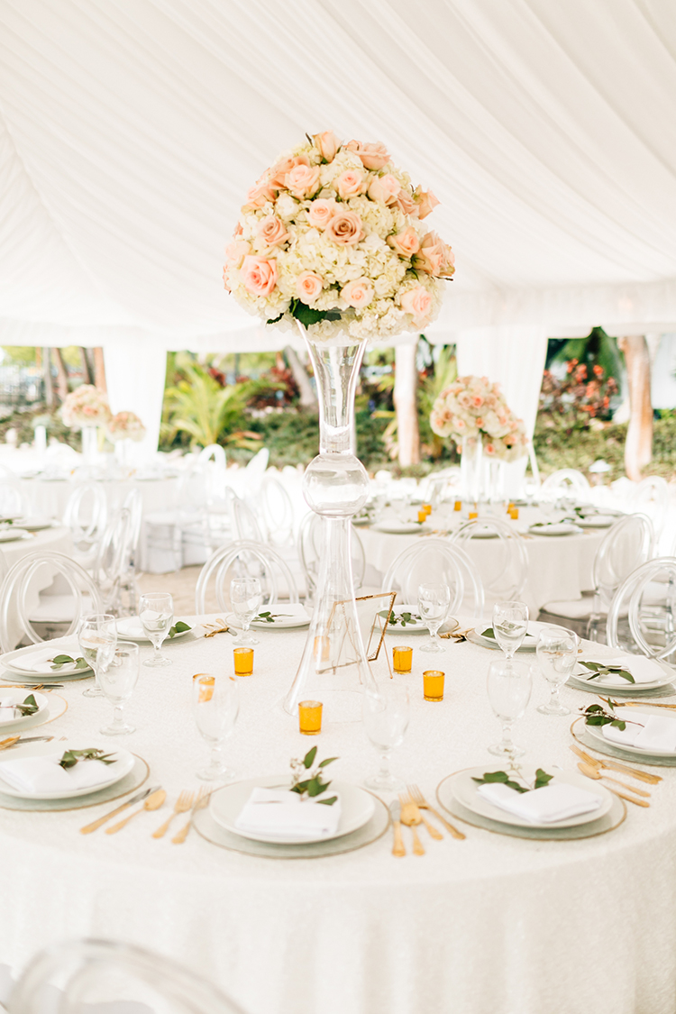 tall pink floral centerpieces - photo by Finding Light Photography https://ruffledblog.com/key-largo-wedding-with-amazing-orchids-and-hydrangea