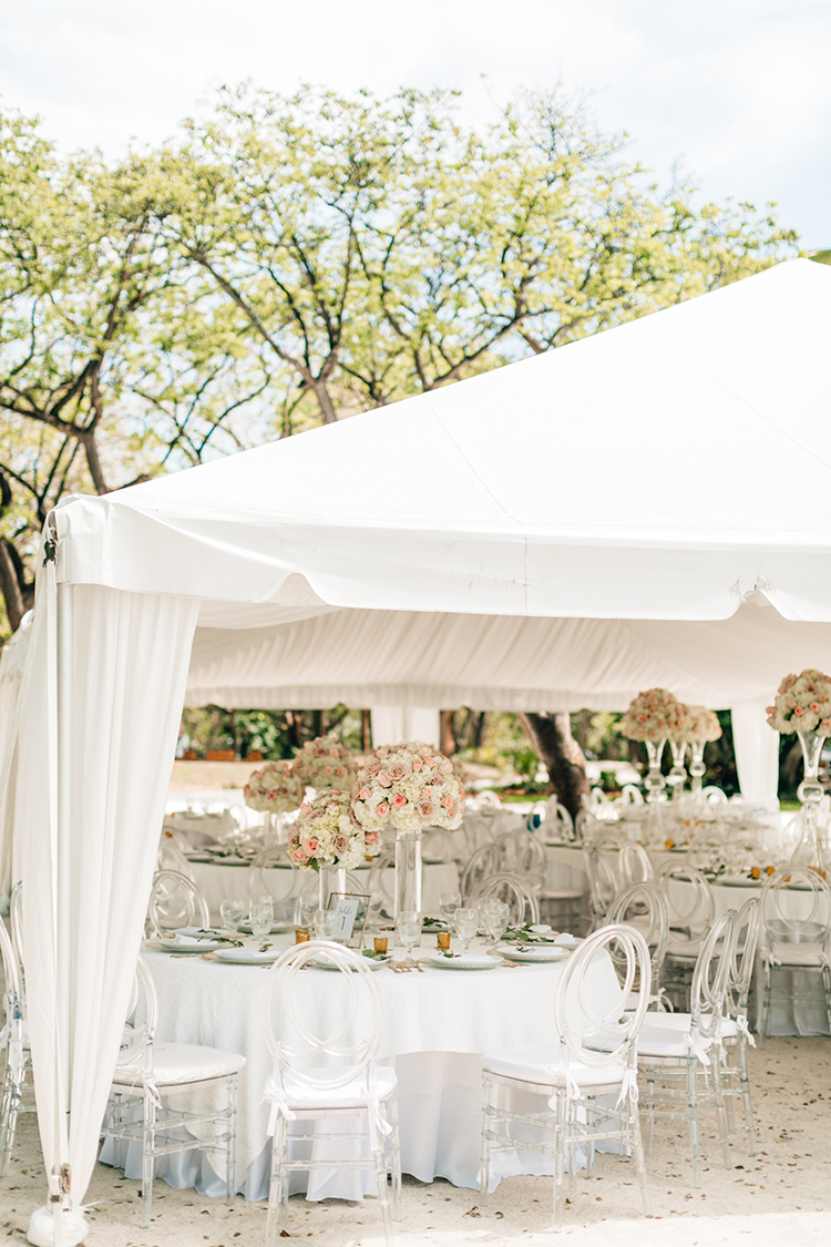 beach wedding receptions under a tent - photo by Finding Light Photography https://ruffledblog.com/key-largo-wedding-with-amazing-orchids-and-hydrangea