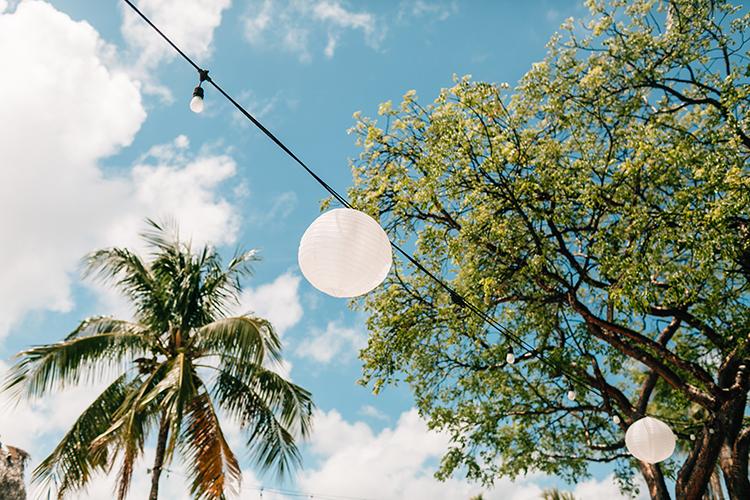 paper lantern weddings - photo by Finding Light Photography https://ruffledblog.com/key-largo-wedding-with-amazing-orchids-and-hydrangea
