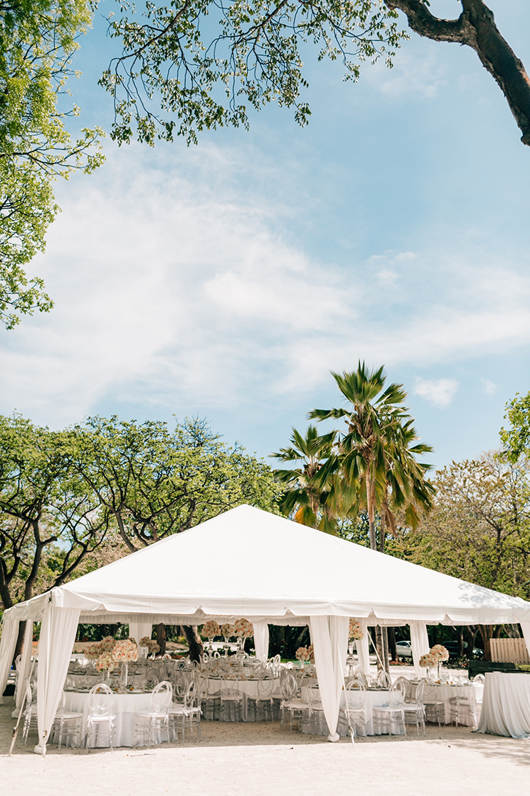 tented wedding receptions - photo by Finding Light Photography https://ruffledblog.com/key-largo-wedding-with-amazing-orchids-and-hydrangea