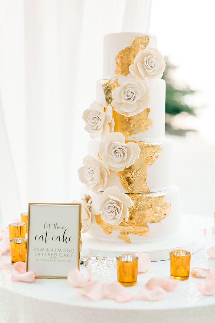 gold and white wedding cakes - photo by Finding Light Photography https://ruffledblog.com/key-largo-wedding-with-amazing-orchids-and-hydrangea