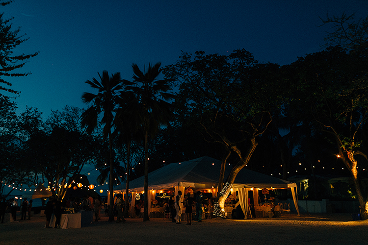 nighttime wedding receptions - photo by Finding Light Photography https://ruffledblog.com/key-largo-wedding-with-amazing-orchids-and-hydrangea