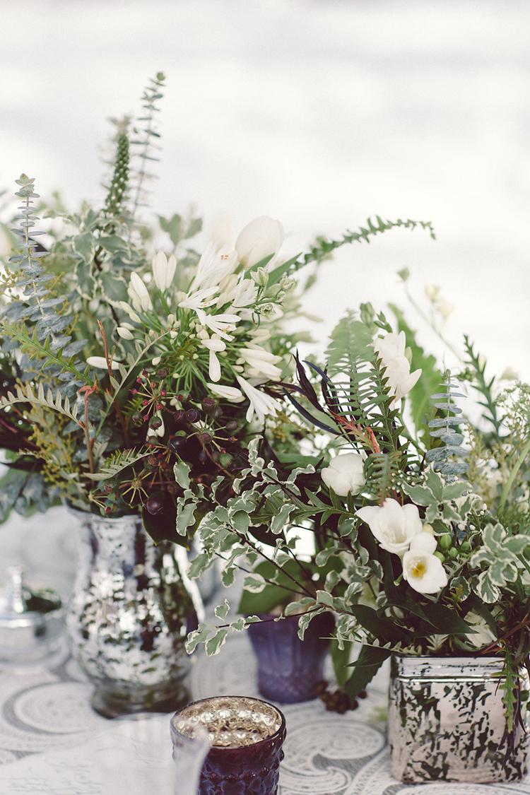 greenery centerpieces - photo by Lilly Red Creative https://ruffledblog.com/lake-tahoe-beach-wedding-inspiration