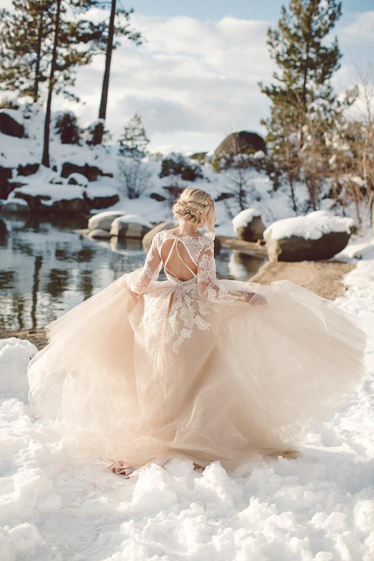blush pink wedding gowns - photo by Lilly Red Creative https://ruffledblog.com/lake-tahoe-beach-wedding-inspiration
