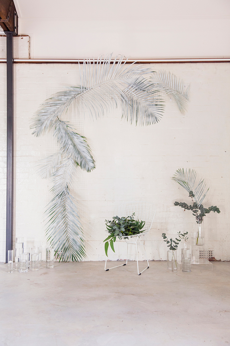 industrial ceremony backdrops - photo by Soda Photography https://ruffledblog.com/leafy-industrial-wedding-inspiration-with-a-wire-table-runner