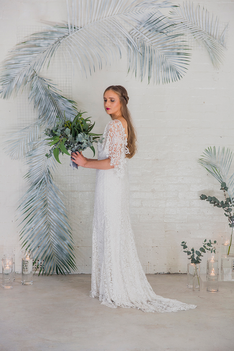 wedding ceremony backdrop ideas - photo by Soda Photography https://ruffledblog.com/leafy-industrial-wedding-inspiration-with-a-wire-table-runner