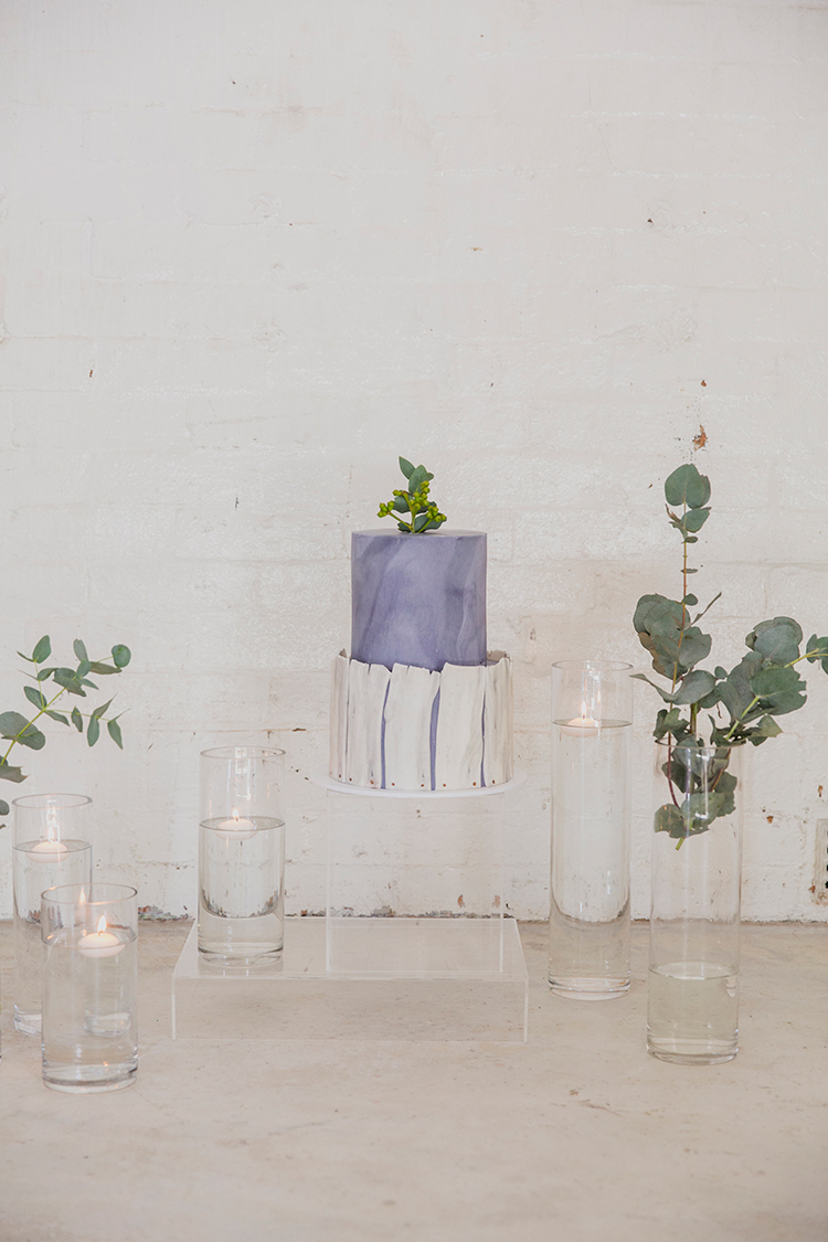 purple wedding cakes - photo by Soda Photography https://ruffledblog.com/leafy-industrial-wedding-inspiration-with-a-wire-table-runner