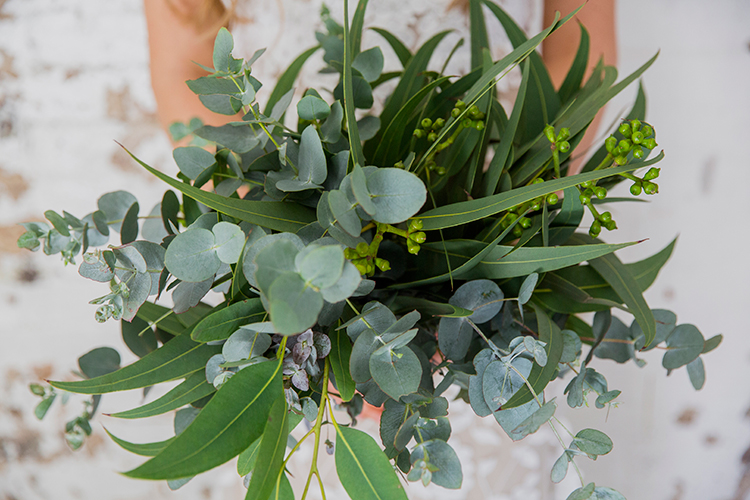tropical wedding bouquets - photo by Soda Photography http://ruffledblog.com/leafy-industrial-wedding-inspiration-with-a-wire-table-runner