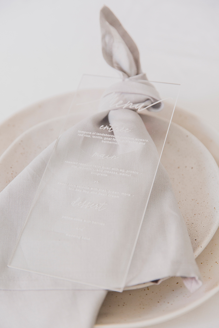 romantic place settings with acrylic menus - photo by Soda Photography https://ruffledblog.com/leafy-industrial-wedding-inspiration-with-a-wire-table-runner