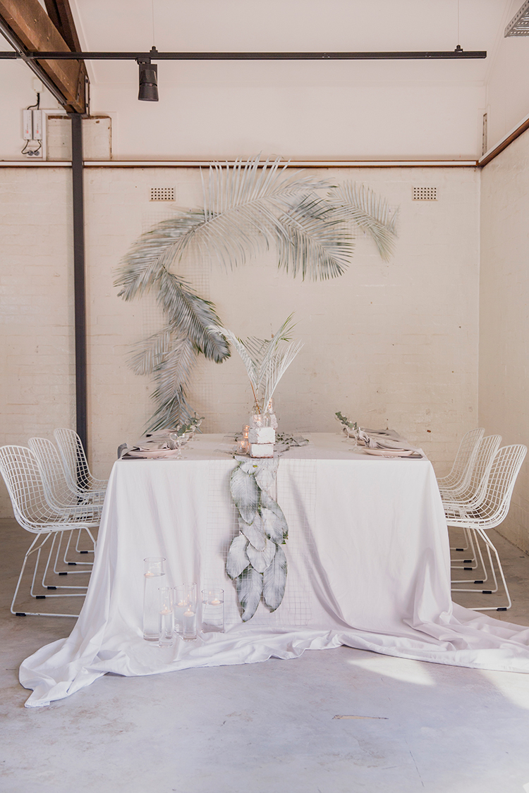 industrial tropical wedding inspiration - photo by Soda Photography http://ruffledblog.com/leafy-industrial-wedding-inspiration-with-a-wire-table-runner