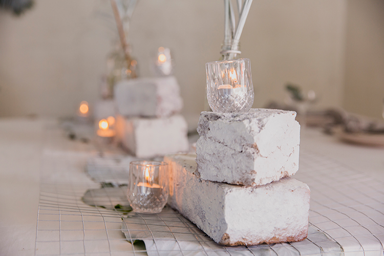 white brick centerpieces - photo by Soda Photography http://ruffledblog.com/leafy-industrial-wedding-inspiration-with-a-wire-table-runner