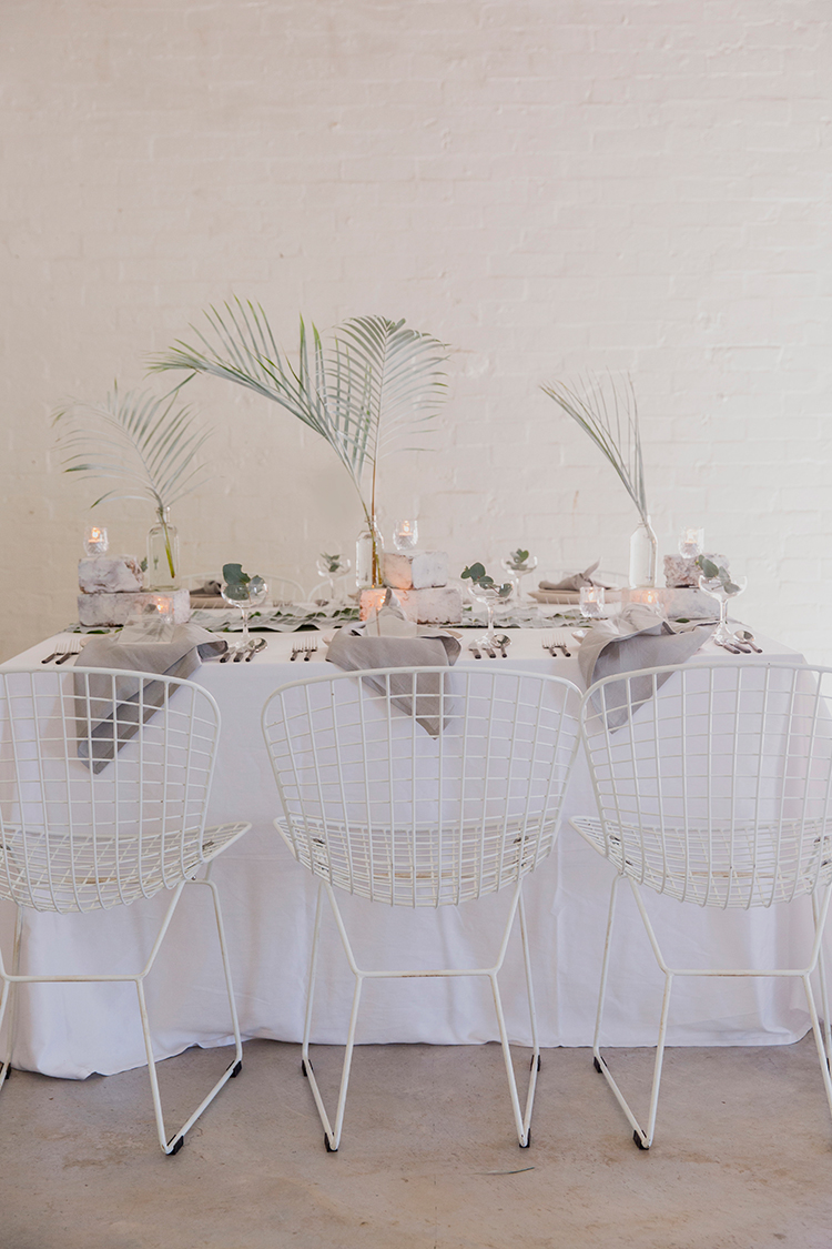 industrial tropical wedding ideas - photo by Soda Photography http://ruffledblog.com/leafy-industrial-wedding-inspiration-with-a-wire-table-runner