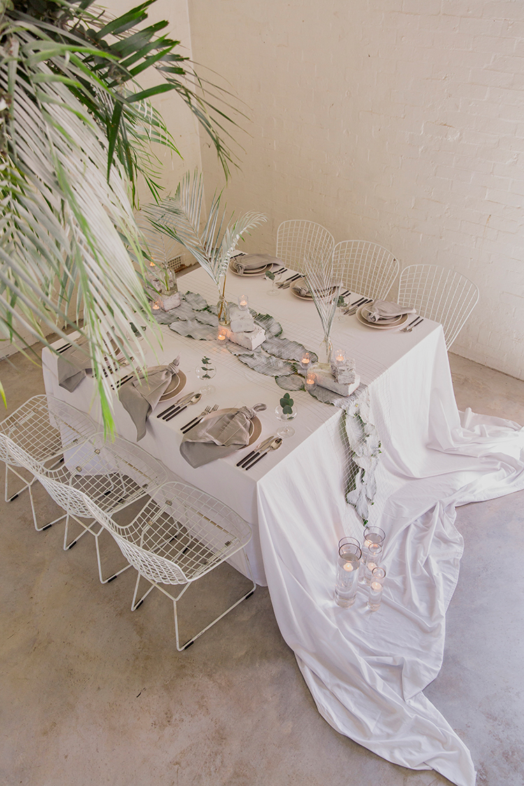 industrial wedding ideas - photo by Soda Photography https://ruffledblog.com/leafy-industrial-wedding-inspiration-with-a-wire-table-runner