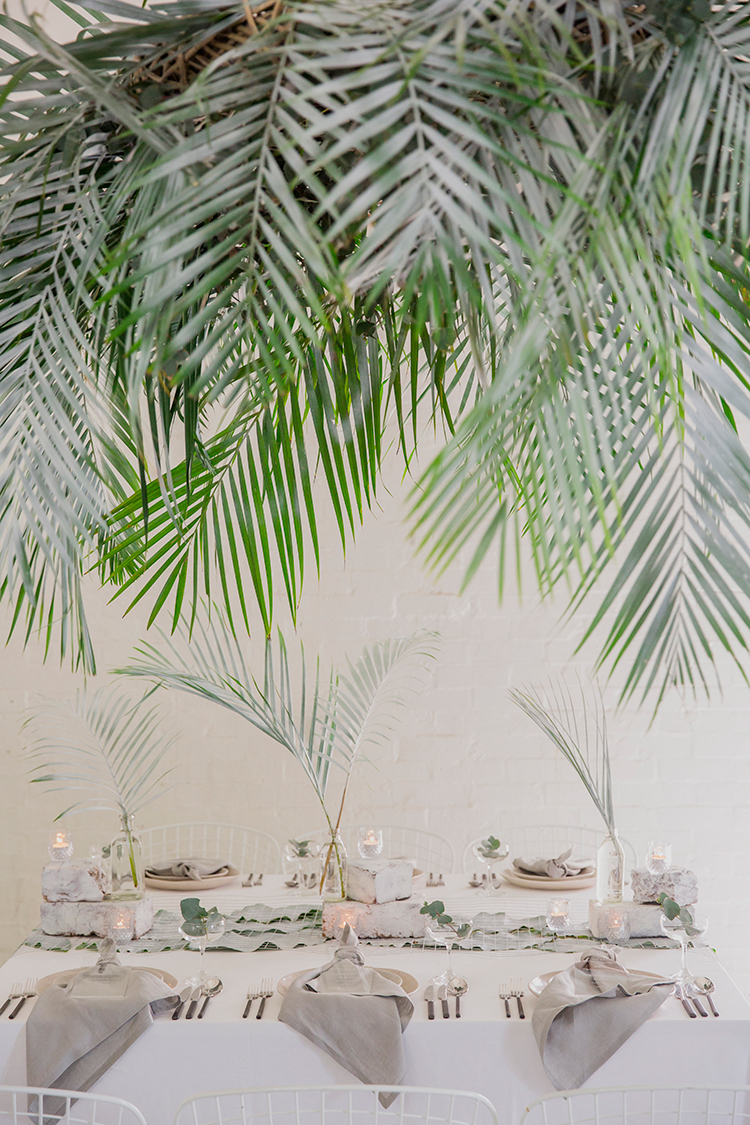 tropical wedding inspiration - photo by Soda Photography https://ruffledblog.com/leafy-industrial-wedding-inspiration-with-a-wire-table-runner