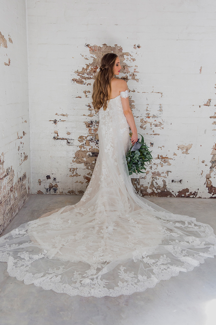 romantic lace wedding dresses - photo by Soda Photography http://ruffledblog.com/leafy-industrial-wedding-inspiration-with-a-wire-table-runner