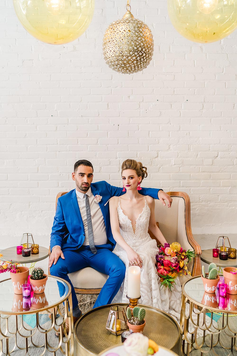 sequined spaghetti strap wedding dress and cobalt blue groom suit