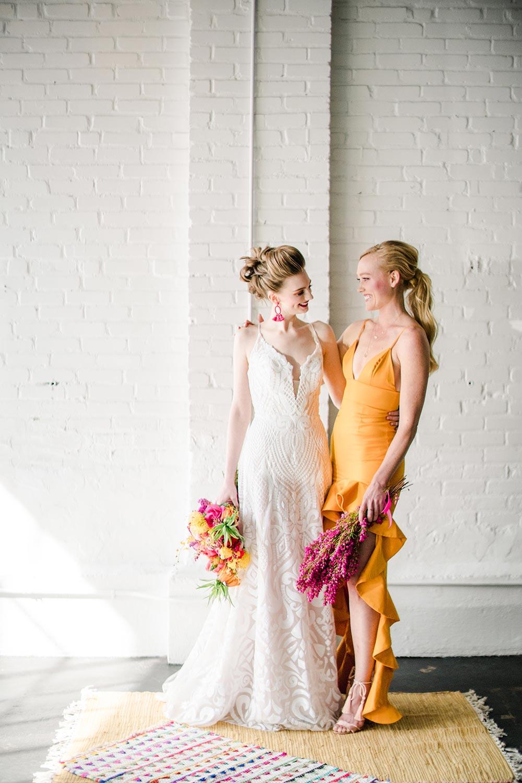 sequined spaghetti strap wedding dress and orange ruffled bridesmaid dress