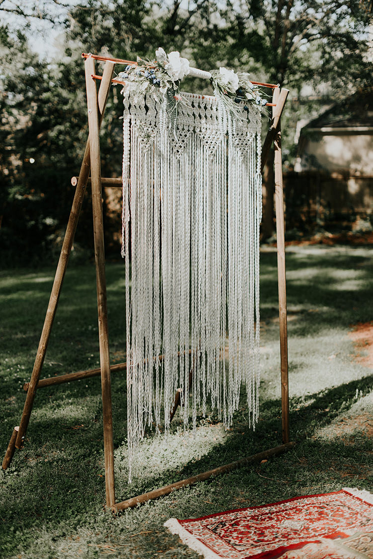 macrame ceremony backdrops - https://ruffledblog.com/lovingly-handcrafted-backyard-wedding-with-boho-details