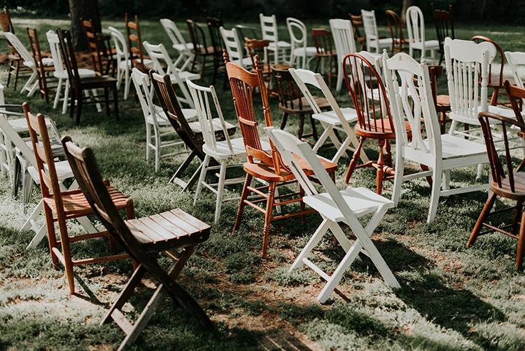 eclectic wedding chairs - https://ruffledblog.com/lovingly-handcrafted-backyard-wedding-with-boho-details