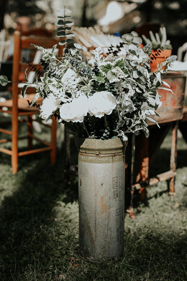 ivory wedding flowers for ceremonies - https://ruffledblog.com/lovingly-handcrafted-backyard-wedding-with-boho-details
