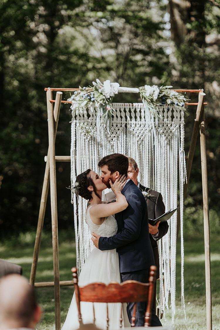 ceremony kisses - https://ruffledblog.com/lovingly-handcrafted-backyard-wedding-with-boho-details