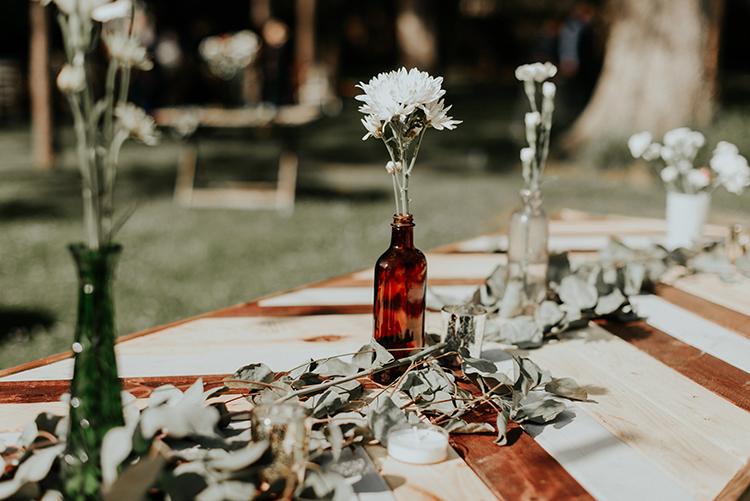 romantic wedding reception tables - https://ruffledblog.com/lovingly-handcrafted-backyard-wedding-with-boho-details