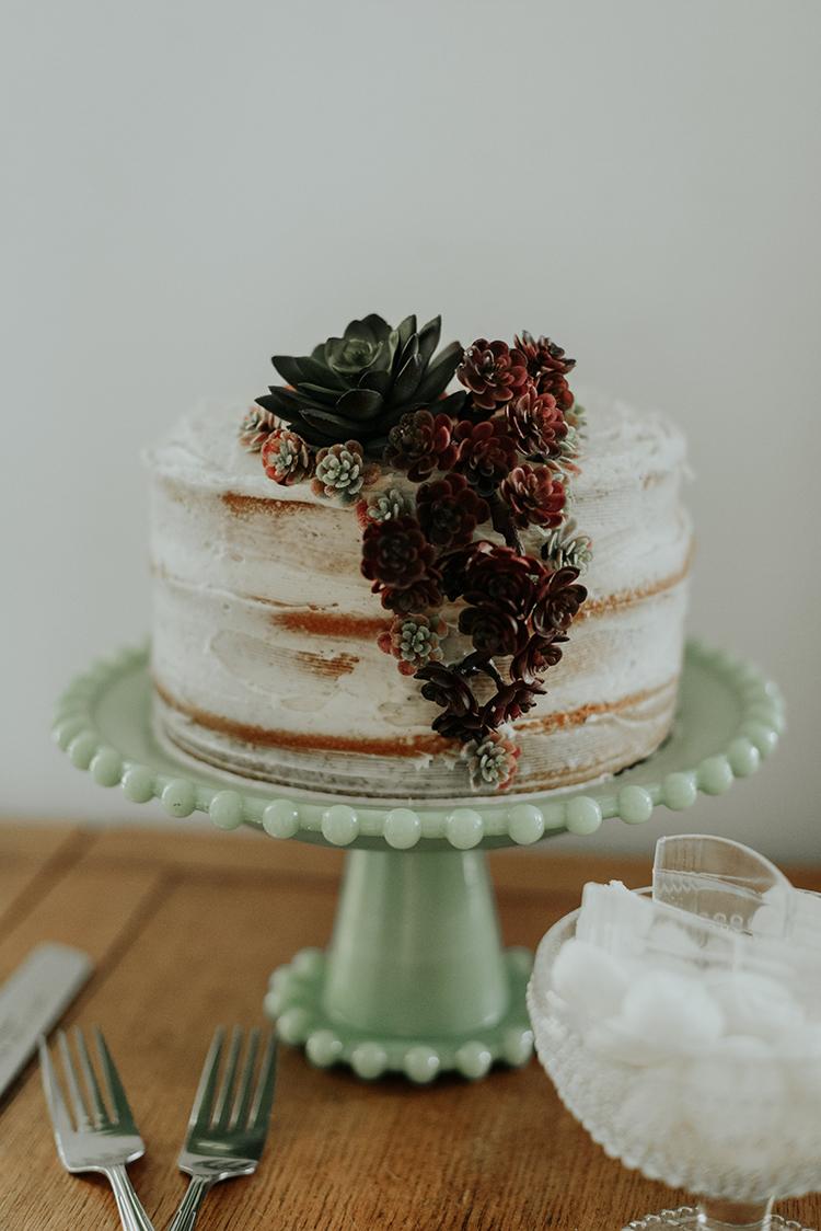 wedding cakes with succulents - https://ruffledblog.com/lovingly-handcrafted-backyard-wedding-with-boho-details