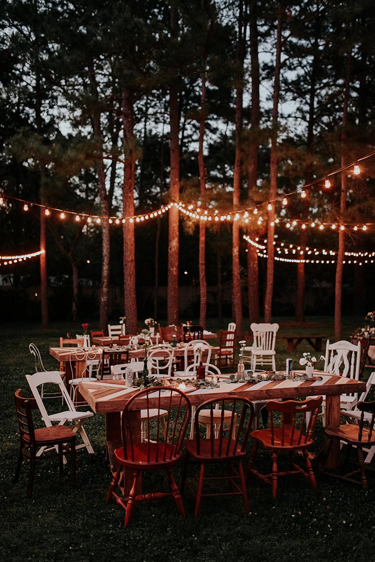 backyard wedding receptions with lights - https://ruffledblog.com/lovingly-handcrafted-backyard-wedding-with-boho-details