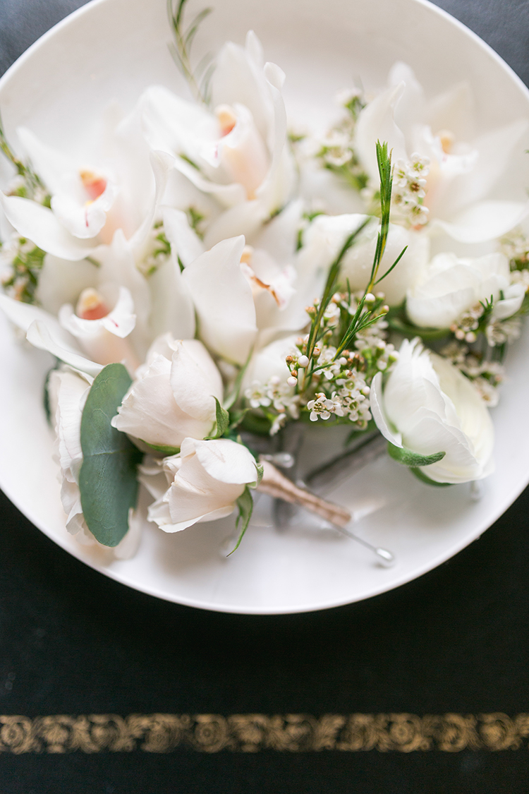 all white boutonnieres - photo by Andy Seo http://ruffledblog.com/lush-romantic-wedding-at-carondelet-house