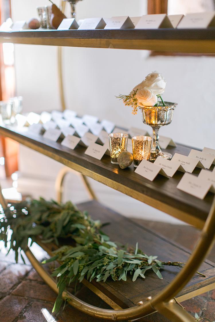 seating chart displays - photo by Andy Seo https://ruffledblog.com/lush-romantic-wedding-at-carondelet-house