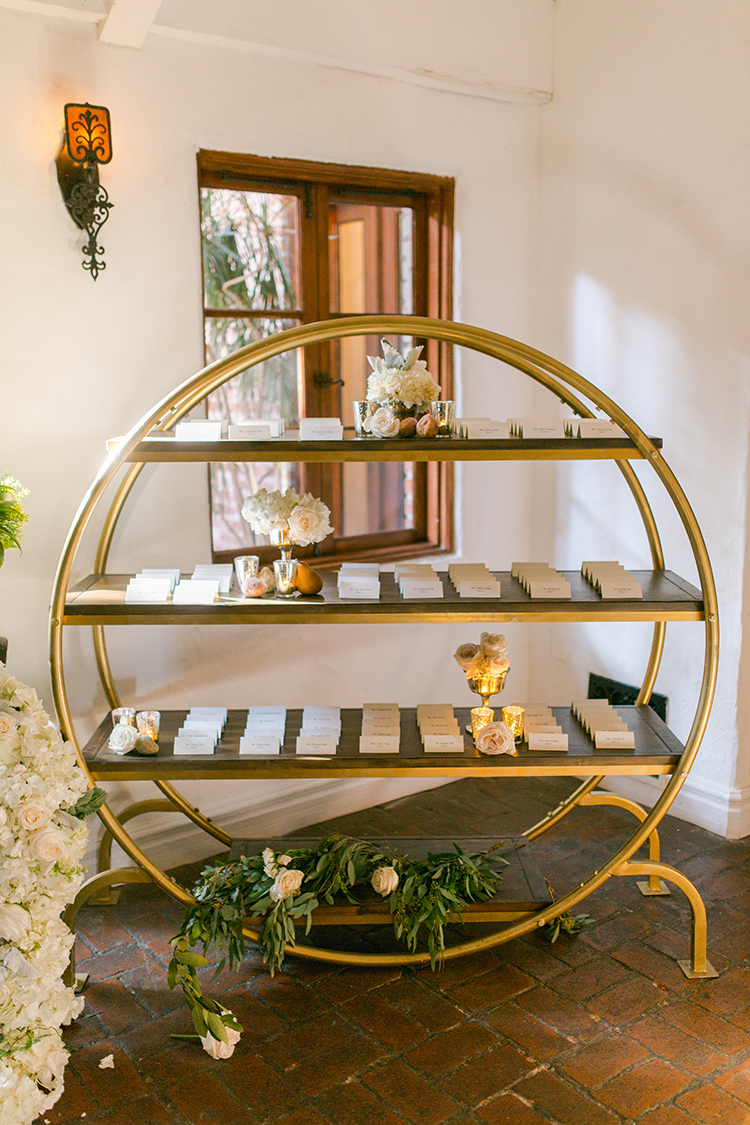 brass seating chart displays - photo by Andy Seo https://ruffledblog.com/lush-romantic-wedding-at-carondelet-house