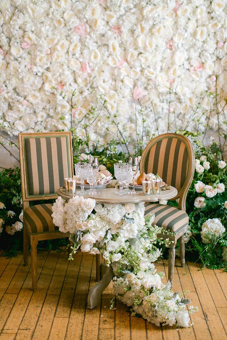 flower wall sweetheart tables - photo by Andy Seo http://ruffledblog.com/lush-romantic-wedding-at-carondelet-house