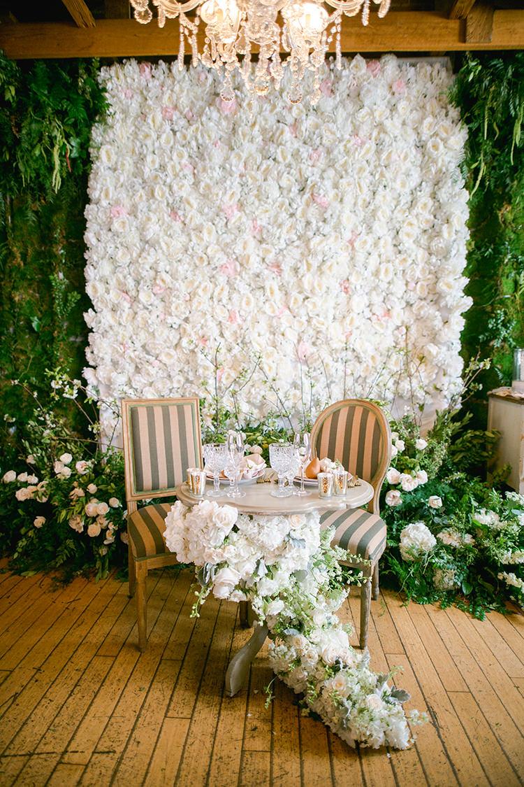 romantic garden wedding sweetheart tables - photo by Andy Seo https://ruffledblog.com/lush-romantic-wedding-at-carondelet-house