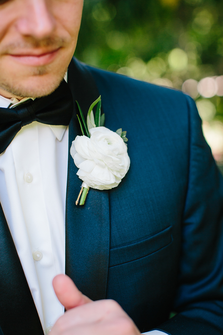 simple white boutonnieres - photo by Mirelle Carmichael https://ruffledblog.com/magical-midsummer-nights-dream-wedding