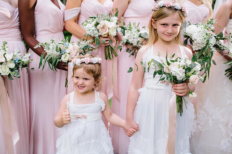 sweet flower girls - photo by Mirelle Carmichael https://ruffledblog.com/magical-midsummer-nights-dream-wedding