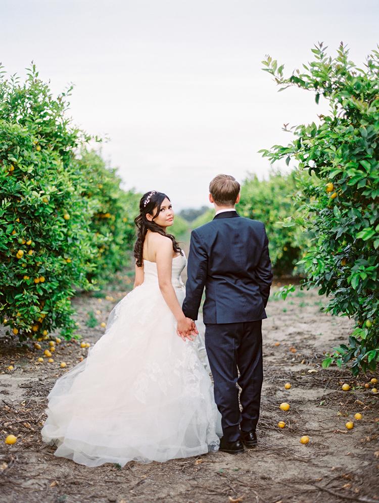 orchard wedding portraits - photo by Mirelle Carmichael https://ruffledblog.com/magical-midsummer-nights-dream-wedding