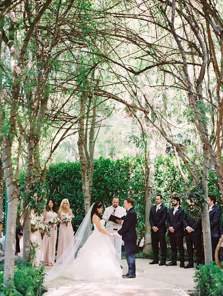 garden wedding ceremonies - photo by Mirelle Carmichael https://ruffledblog.com/magical-midsummer-nights-dream-wedding